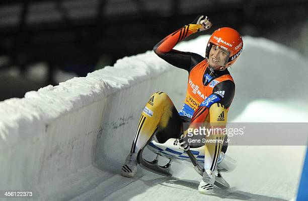 Natalie Geisenberger of Germany gestures as she crosses the finish line in first place winning the Women's Luge competition at the Viessmann Luge...