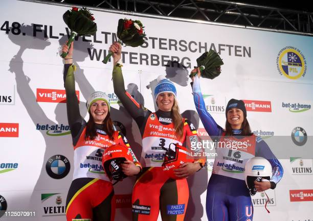 Natalie Geisenberger of Germany Julia Taubitz of Germany and Emily Sweeney of USA celebrate after the final run of the Luge World Championships Women...