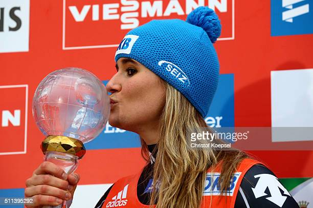 Natalie Geisenberger of Germany kisses the World Cup trophy after winning the World Cup season on the podium after the second rn of the Viessmann...