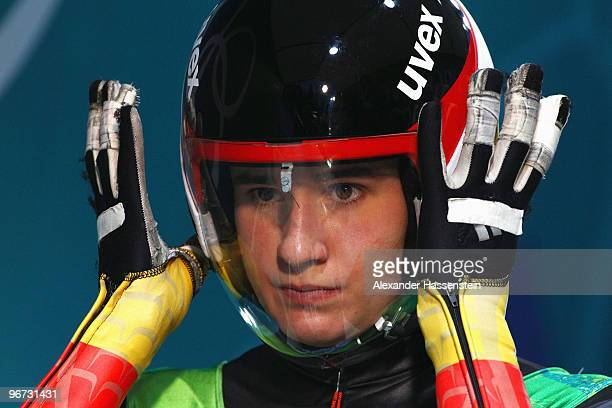Natalie Geisenberger of Germany prepares her visor ahead of the Luge Women's Singles on day 4 of the 2010 Winter Olympics at Whistler Sliding Centre...
