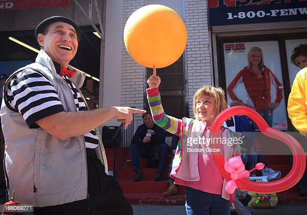 Natalie George of Atlanta Ga spins a yellow ball on her finger with the help of Benjamin Elfant left a master juggler from the Moscow Circus George...