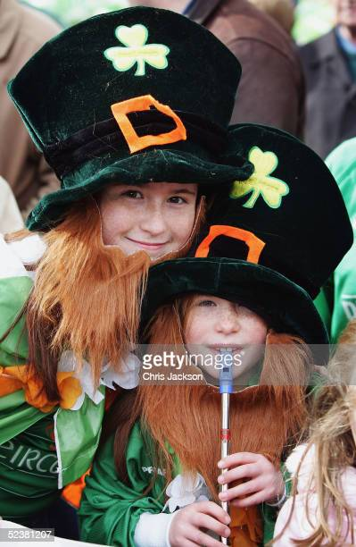 Natalie Giarino and Norana Giarino join in the St Patrick's Day march on March 13, 2005 in London, England. Around 25,000 people are expected to...