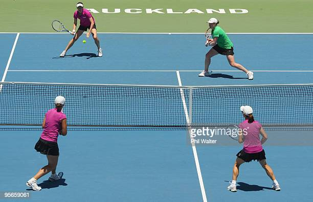 Natalie Grandin of South Africa and Laura Granville of the USA play at the net during their doubles final match against Cara Black of Zimbabwe and...
