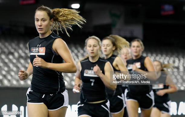 Natalie Grider performs in the 2km time trial during the AFLW Draft Combine at Marvel Stadium on October 3 2018 in Melbourne Australia
