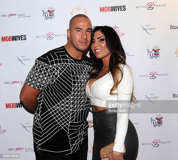 Natalie Guercio of Mob Wives and her boyfriend London Rene attends Mob Wives Season Five Viewing Party at Drunken Monkey on December 3 2014 in New...