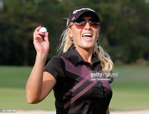 Natalie Gulbis acknowledges the crowd on the 17th hole during the third round of the CME Group Titleholders at Tiburon Golf Club on November 23 2013...
