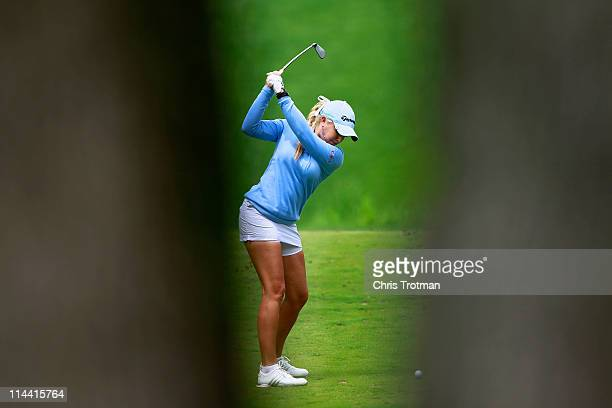 Natalie Gulbis hits her tee shot on the eighth hole during round one of the Sybase Match Play Championship at Hamilton Farm Golf Club on May 19 2011...