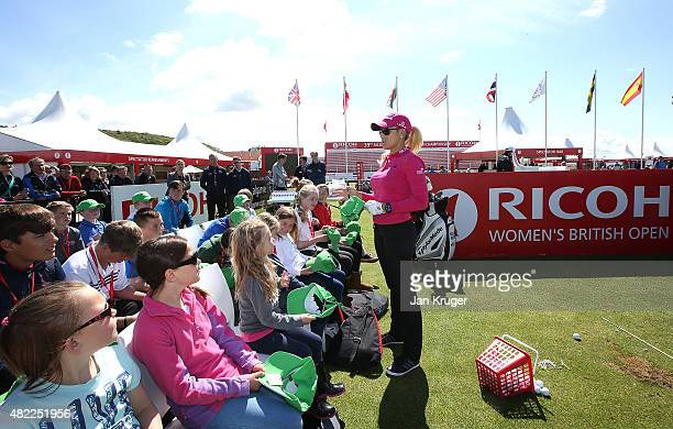 Natalie Gulbis of the United States answers questions from local children during a junior clinic ahead of the Ricoh Women's British Open on the Ailsa...