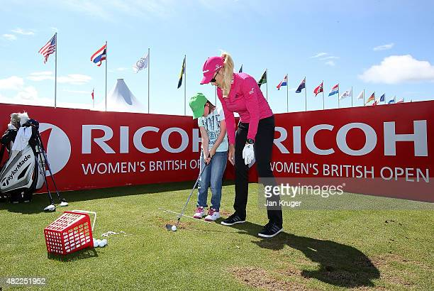 Natalie Gulbis of the United States gives a demontration during a junior clinic to local children ahead of the Ricoh Women's British Open on the...