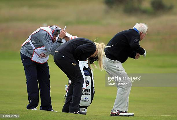 Natalie Gulbis of the USA her caddie and one of her proam partners duck for a stray ball during the proam for the 2011 Ricoh Women's British Open at...