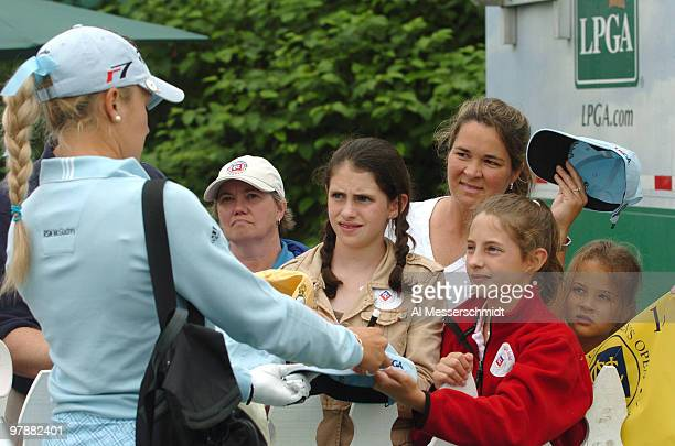 Natalie Gulbis signs autographs at the driving range at Newport Country Club site of the 2006 U S Women's Open in Newport Rhode Island June 29 Fog...