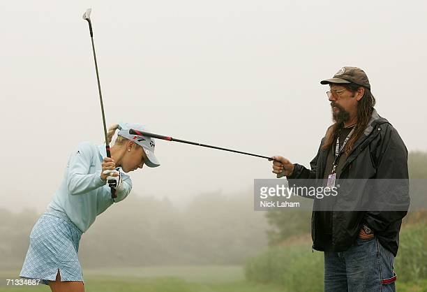 Natalie Gulbis takes some swing advice from her father John Gulbis on the practice range before the first round of the 2006 Women's US Open at...