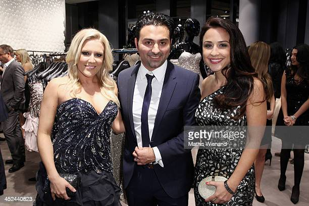 Natalie Horler and Nina Moghaddam with Shahin Moghadam attend the Unique Flagship Store Opening at the new 'Koe Bogen' on November 28 2013 in...