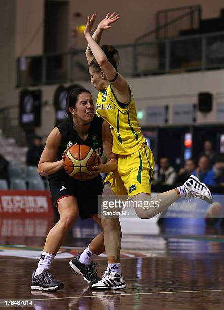 Natalie Hurst of Australia defends Micaela Cocks of New Zealand during the Women's FIBA Oceania Championship match between the New Zealand Tall Ferns...