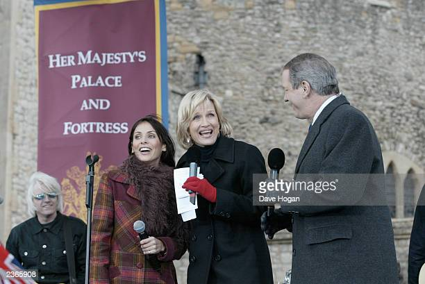 Natalie Imbruglia on Good Morning America with host Diane Sawyer and Charles Gibson at the Tower of London in London England on February 6 2002 Photo...