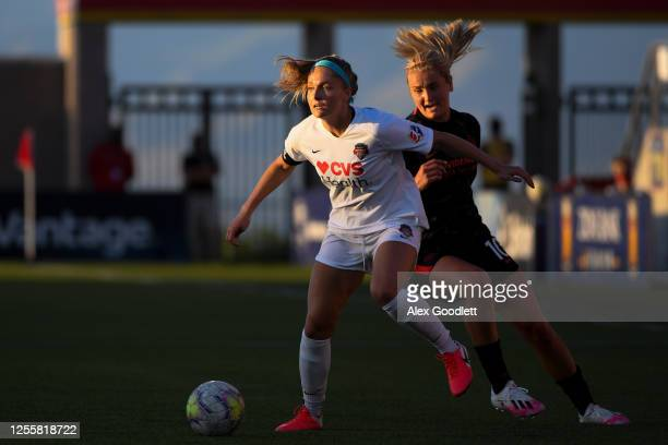 Natalie Jacobs of Washington Spirit attempts to drie around Lindsey Horan of Portland Thorns FC during a game on day 5 of the NWSL Challenge Cup at...