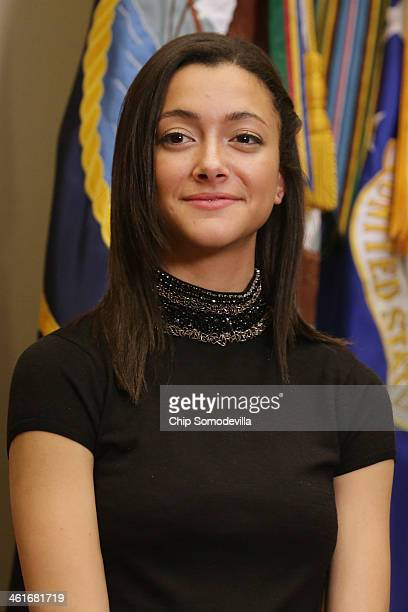 Natalie Johnson daughter of Homeland Security Secretary Jeh Johnson participates in his ceremonial swearing in to office in the Roosevelt Room at the...