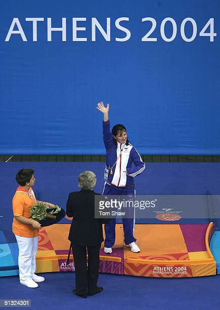 Natalie Jones of Great Britain gestures while on the podium with her Gold at the Athens 2004 Paralympic Games on September 19 2004 at the Olympic...