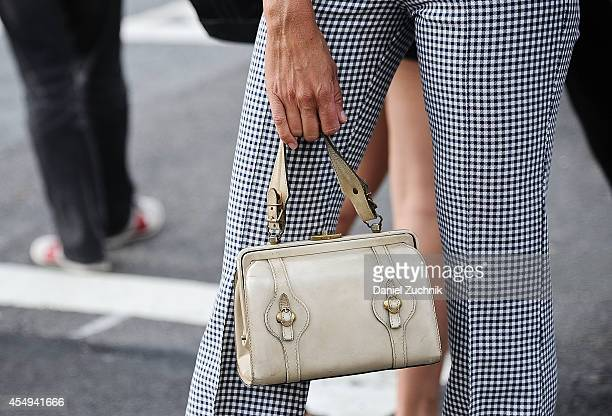 Natalie Joos is seen outside the Thakoon show wearing vintage pants and bag on September 7 2014 in New York City