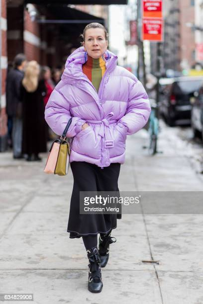 Natalie Joos wearing a pink down feather jacket outside Tibi on February 11 2017 in New York City