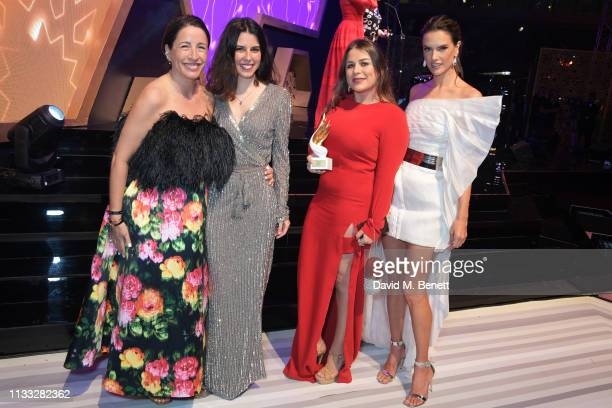 Natalie Kingham and Alessandra Ambrosio pose with Zyne designers Zineb Britel Laura Pujol winners of the Accessories award for footwear attend the...