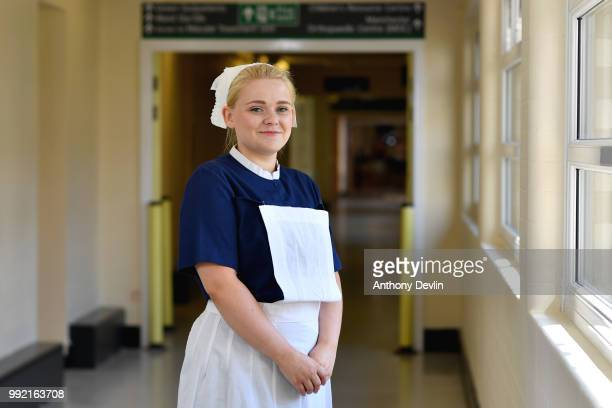 Natalie Lancaster represents the 1950s as nurses in uniforms to represent each decade of the NHS Trafford Hospital pose for a portrait to celebrate...