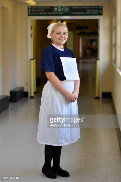 Natalie Lancaster represents the 1950's as nurses in uniforms to represent each decade of the NHS Trafford Hospital pose for a portrait to celebrate...