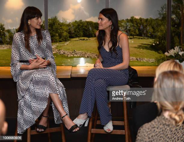 Natalie Lim Suarez and Alia AhmedYahia attend the KORS VIP X ELLE luncheon at Loring Place on July 27 2018 in New York City