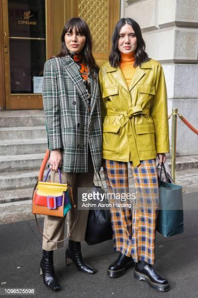 Natalie Lim Suarez is seen wearing a green Prada coat Sonya Rykiel top a Rag Bone sunglasses and a Boyy purse Dylana Suarez is seen wearing a vintage...