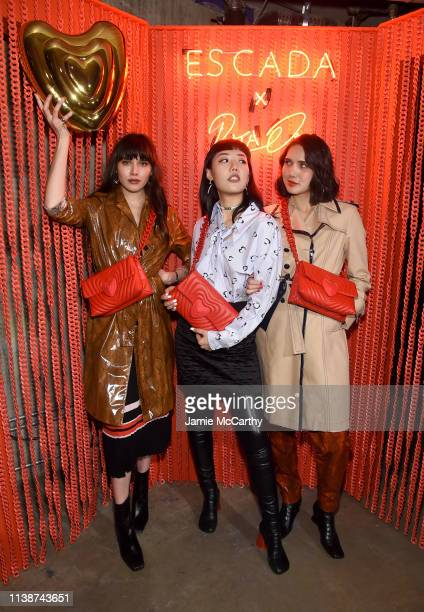 Natalie Lim Suarez Michelle Song and Dylana Suarez attend the launch of the ESCADA Heartbag by Rita Ora on March 27 2019 in New York City