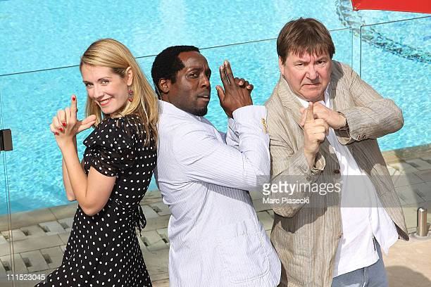 Natalie Lisinska Richard Yearwood and Remy Girard attend the 'InSecurity' photocall during the MIPTV 2011 at Hotel Majestic on April 4 2011 in Cannes...