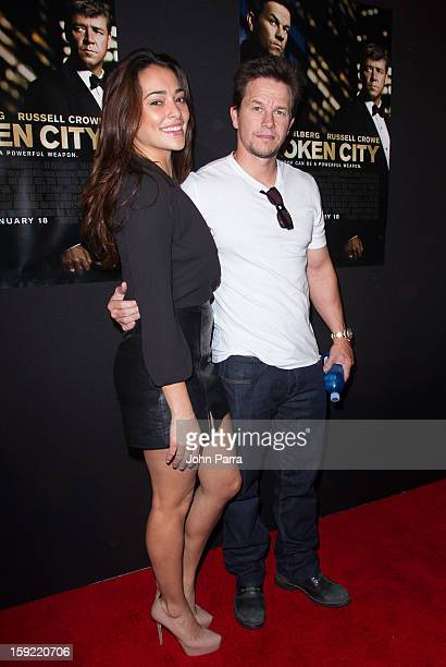 Natalie Martinez and Mark Wahlberg attend the screening of 'Broken City' at Regal South Beach on January 9 2013 in Miami Florida