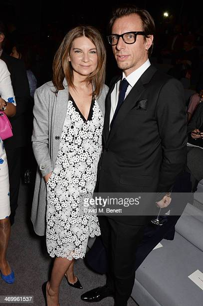 Natalie Massenet and Erik Torstensson attend the TOM FORD show at London Fashion Week AW14 at The Lindley Hall on February 17 2014 in London England