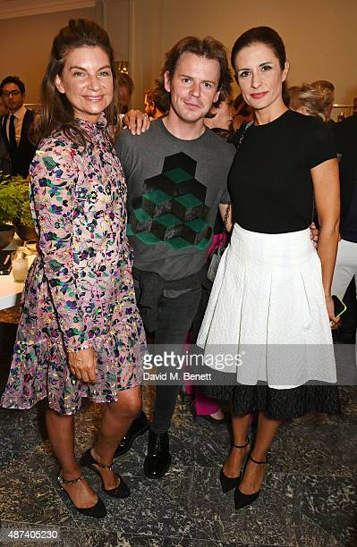 Natalie Massenet, Christopher Kane and Livia Firth attend the launch of the first Erdem flagship store on September 9, 2015 in London, England.
