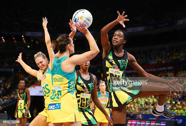 Natalie Medhurst of the Diamonds shoots as KadieAnn Dehaney of Jamaica defends during the 2015 Netball World Cup Semi Final 2 match between Australia...
