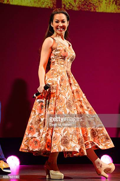 Natalie Mendoza and the cast of 'Here Lies Love' perform at the 60th London Evening Standard Theatre Awards at the London Palladium on November 30...