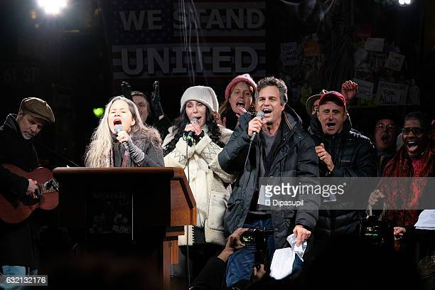 Natalie Merchant Cher and Mark Ruffalo sing onstage during the We Stand United NYC Rally outside Trump International Hotel Tower on January 19 2017...