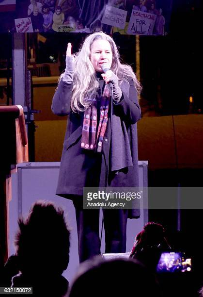 Natalie Merchant gives a speech as people gather in front of Trump International Hotel Tower in New York USA on January 19 2017 during a...