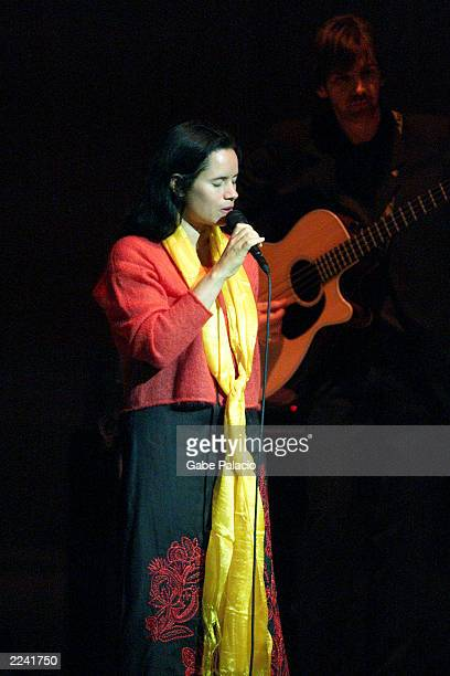 Natalie Merchant on stage performing during the Tibet House Benefit Concert 2001 with artistic director Philip Glass Dana Bryant Emmylou Harris Patti...