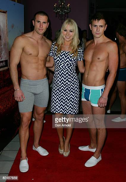 Natalie Michaels poses alongside models during the official launch of the AceStar underwear range at Pink Salt on August 19, 2008 in Sydney,...