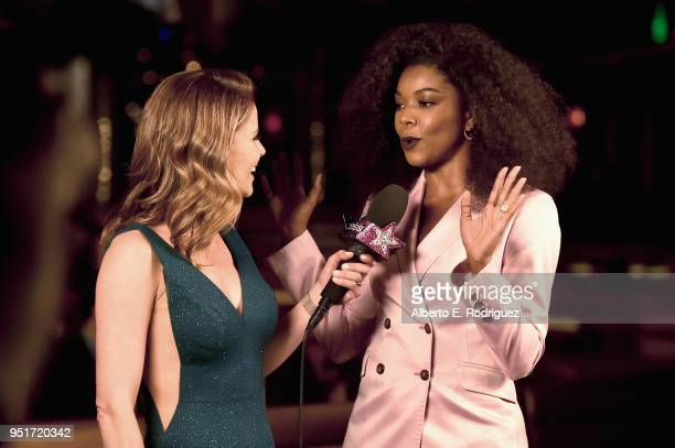 Natalie Morales and actress Gabrielle Union talk during the CinemaCon Big Screen Achievement Awards brought to you by the CocaCola Company at The...