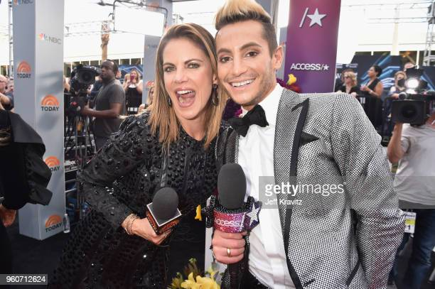 Natalie Morales and Frankie J Grande attend the 2018 Billboard Music Awards at MGM Grand Garden Arena on May 20 2018 in Las Vegas Nevada