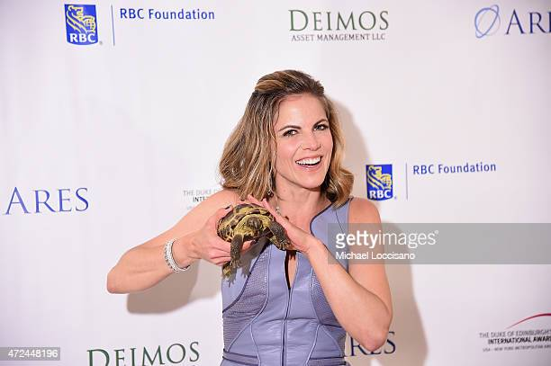 Natalie Morales poses with a turtle at the 2015 DofE USANYMA Adventurous Journey Dinner Auction at JW Marriott Essex House on May 7 2015 in New York...