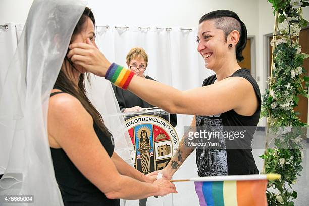 Natalie Novoa wipes the tears off her partner Eddie Daniels' cheeks during their wedding ceremony at the LA County Registrars office on June 26 2015...