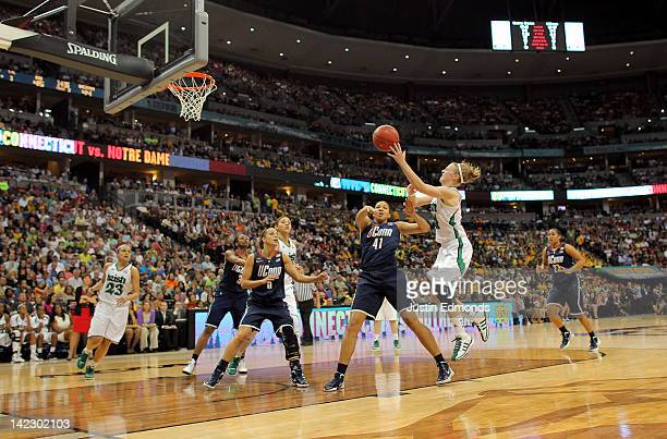 Natalie Novosel of the Notre Dame Fighting Irish attempts a shot in the second half against Kiah Stokes of the Connecticut Huskies during the...