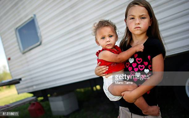 Natalie Parker hold hers sister Savannah Riley 9 months outside their FEMA trailer May 31 2008 in Buras Louisiana Parker's mother says she has...