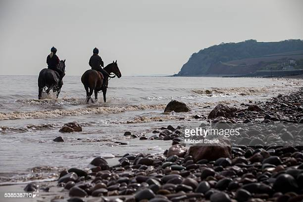 Natalie Parker riding Bincombe and Kate Tracey riding Return Spring at Blue Anchorl Beach on May 6 2016 in Minehead England Sandhill Racing Stables...