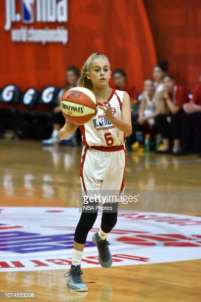 Natalie Picton of Canada Girls passes the ball against the South America Girls during the Jr NBA World Championships Tournament in Orlando Florida at...