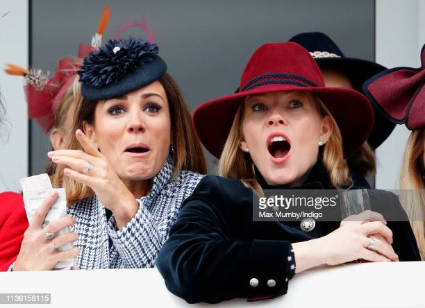 Natalie Pinkham and Autumn Phillips watch the racing as they attend day 4 'Gold Cup Day' of the Cheltenham Festival at Cheltenham Racecourse on March...