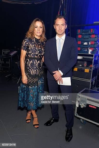 Natalie Pinkham and Jude Law pose backstage at the SeriousFun London Gala 2016 at The Roundhouse on November 3 2016 in London England